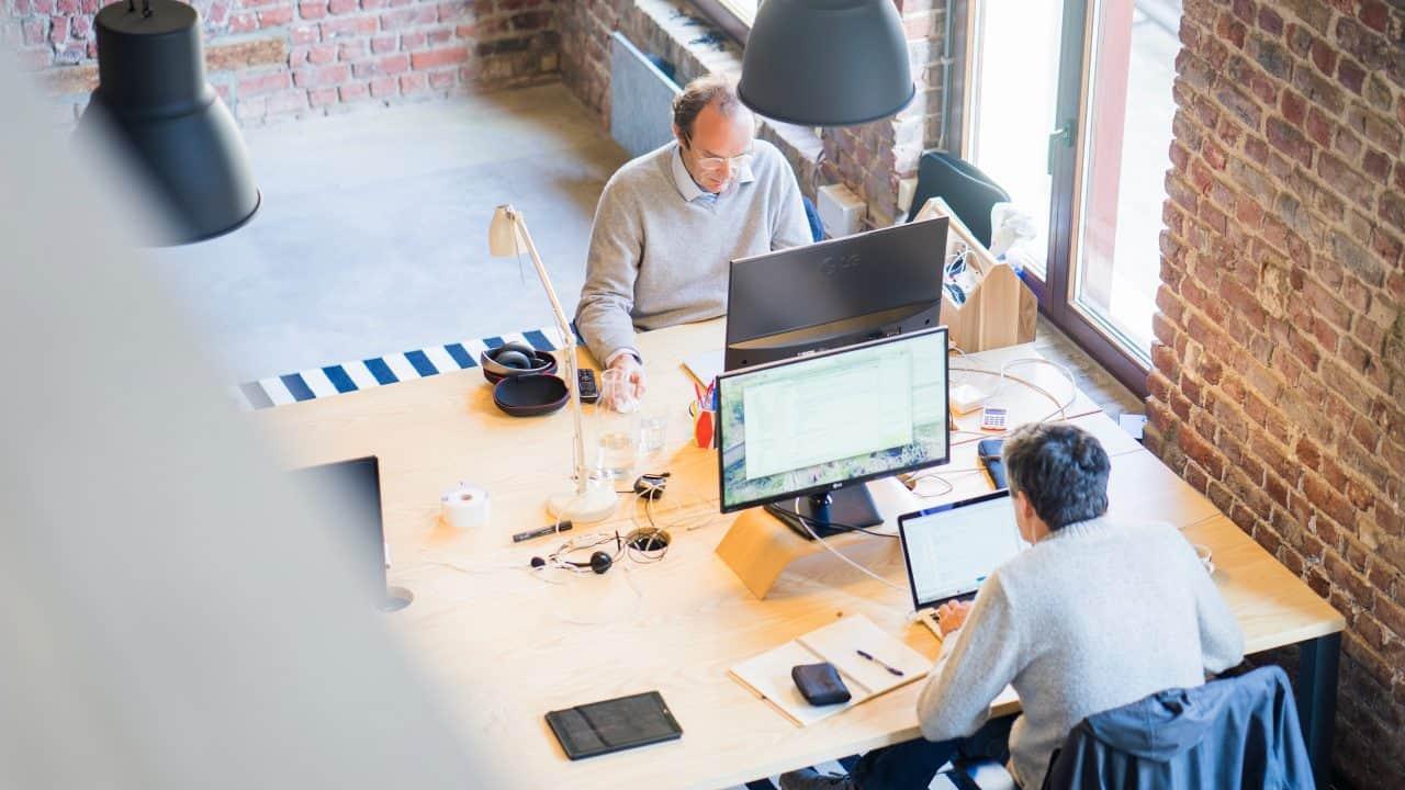 https://digitalhealthbuzz.com/wp-content/uploads/2020/02/two-men-sitting-facing-on-flat-screen-monitors-2451646-1280x720.jpg